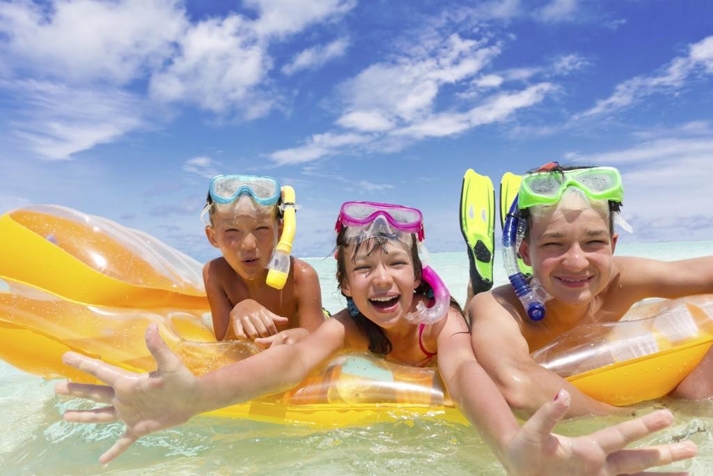 Three kids on a raft